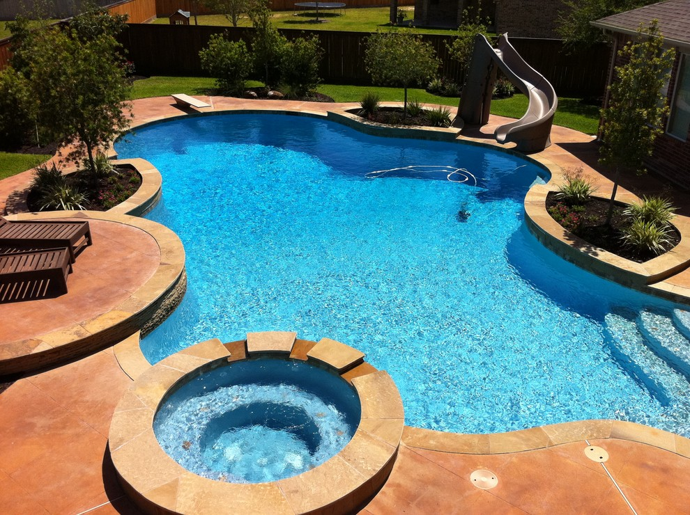Freeform Pool With Diving Board Slide Traditional Pool Houston By Great Escapes Custom Pools