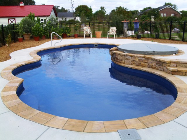 Freeform Pools Deep Blue Fiberglass With Tennessee Crab Orchard Stone Coping And Traditional