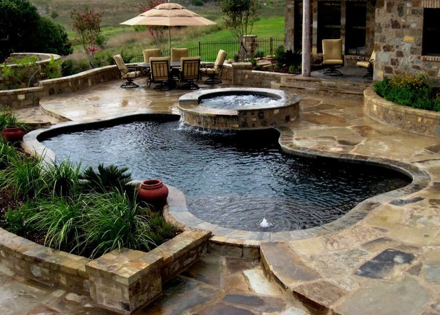 Freeforms With Flagstone Decking Tropical Pool Austin By Artisan Pool And Spa