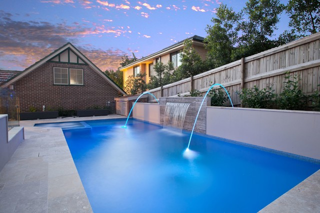Photo of a medium sized contemporary back rectangular swimming pool in Sydney with a water feature.