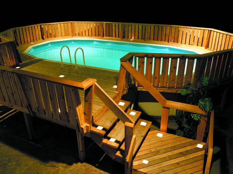 Inspiration for a mid-sized timeless backyard round aboveground pool remodel in Austin with decking