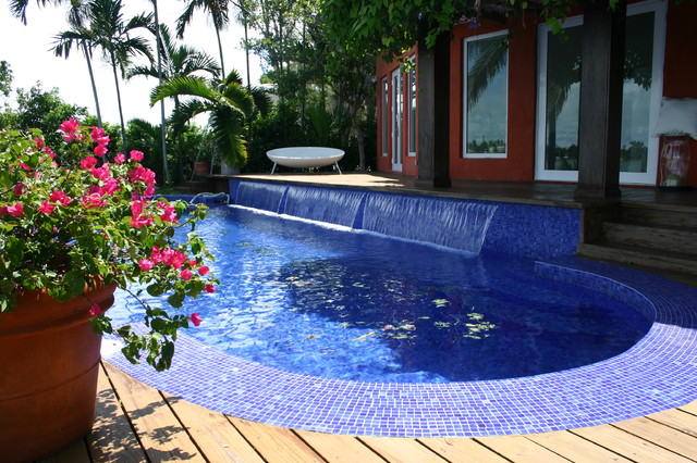 Glass tile pool with oversize waterfall contemporary for Pool design miami