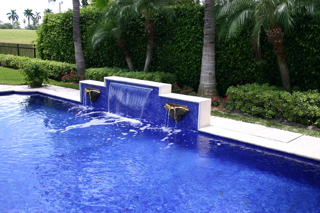 Glass tile waterfall eclectic-pool