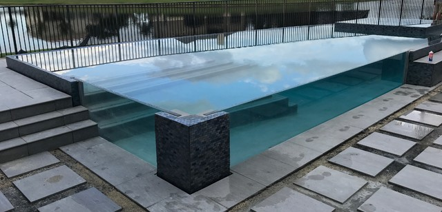 glass wall pool with sunken living room - Industrial ...