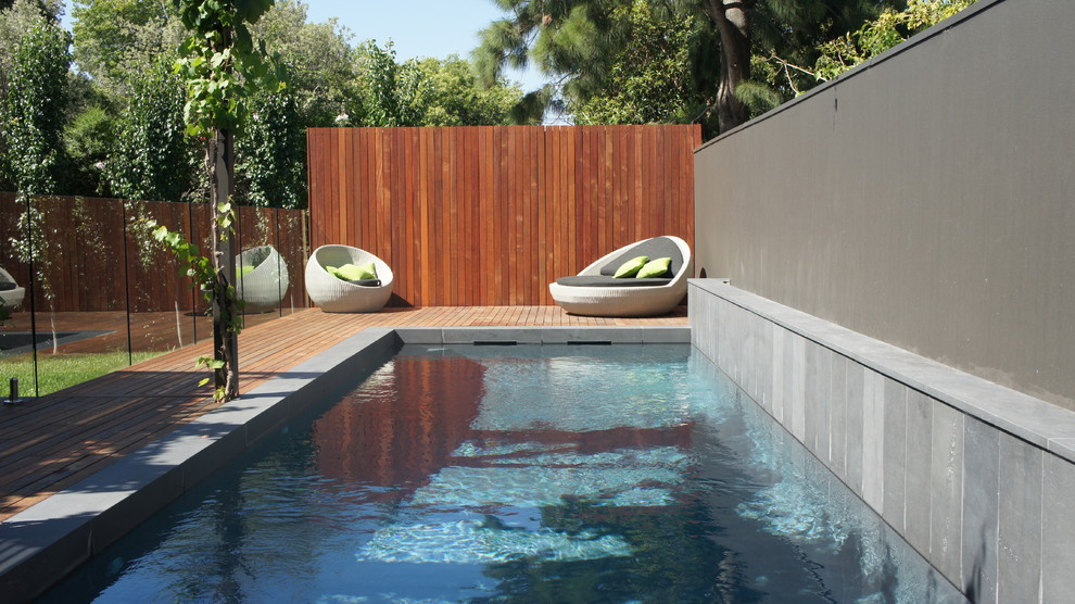 Inspiration for a mid-sized contemporary rectangular lap pool remodel in Melbourne with decking