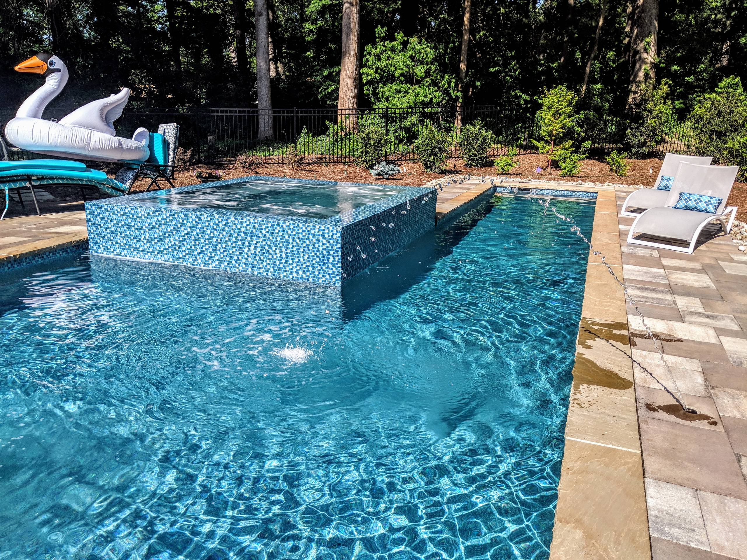 Gorgeous Glass Tile 360 Spillover Spa and lap pool