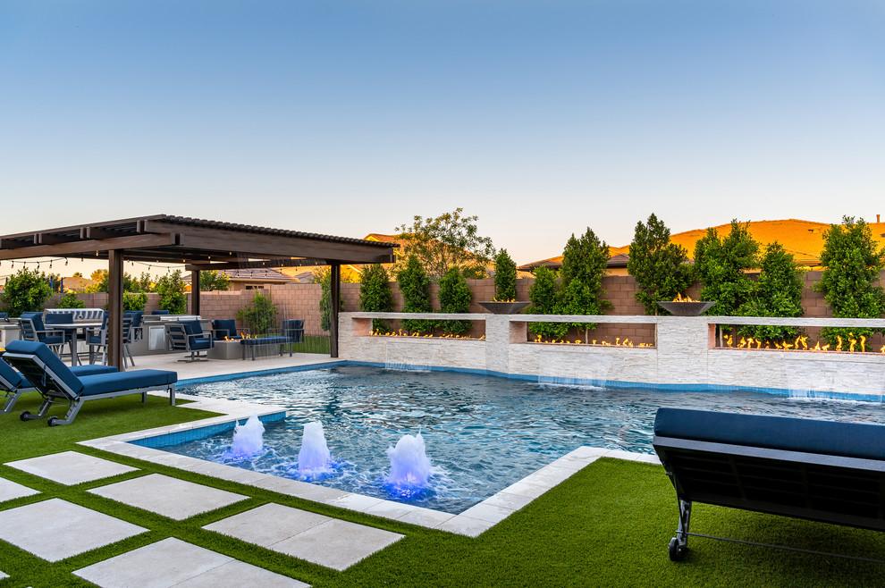 Example of a large trendy backyard rectangular pool fountain design in Phoenix