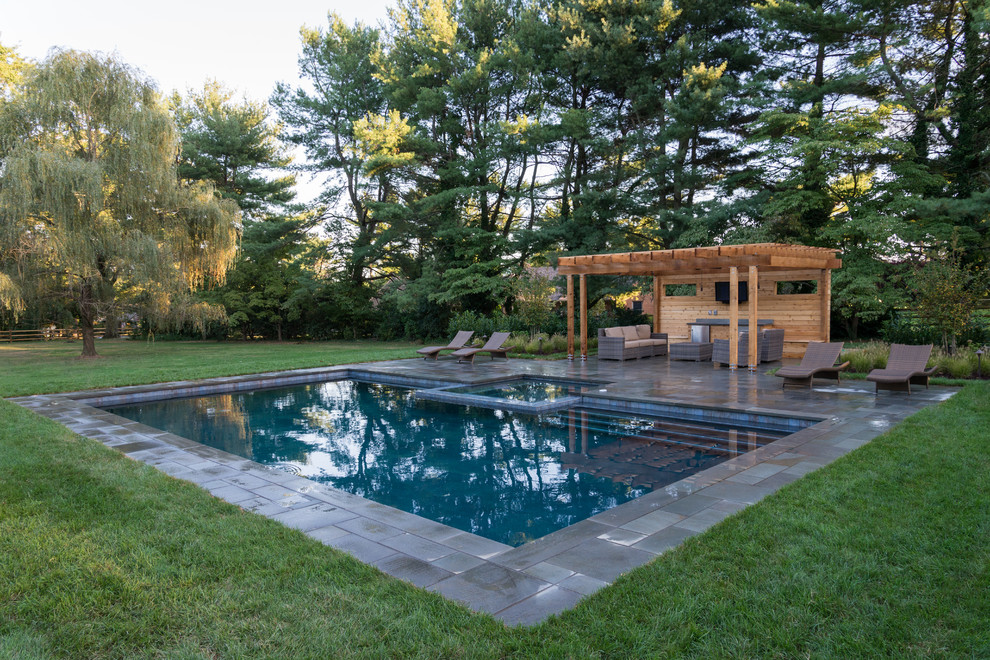 Inspiration for a rustic tile and rectangular hot tub remodel in Philadelphia