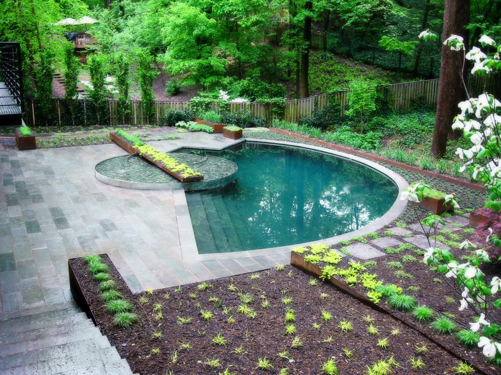 Pool - contemporary custom-shaped pool idea in DC Metro
