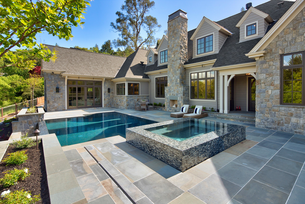 Inspiration for a large contemporary backyard stone and rectangular hot tub remodel in San Francisco