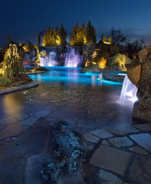 Swim through grottos lazy river waterfalls highlight for Swimming pool design utah