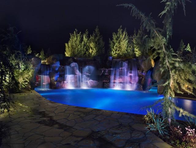 Swim through grottos lazy river waterfalls highlight for Pool kings design