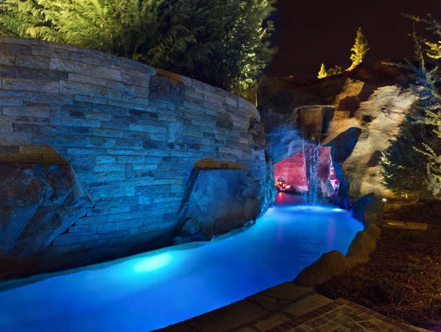Swim through grottos lazy river waterfalls highlight for Pool design okc