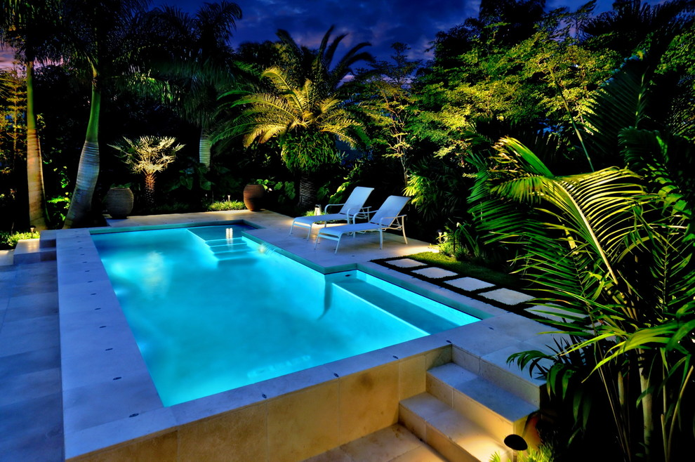 Inspiration for a tropical rectangular pool remodel in Miami