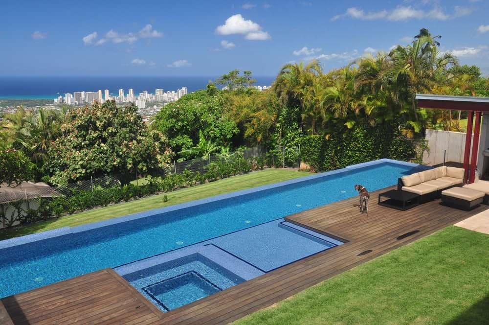 Island style pool photo in Hawaii