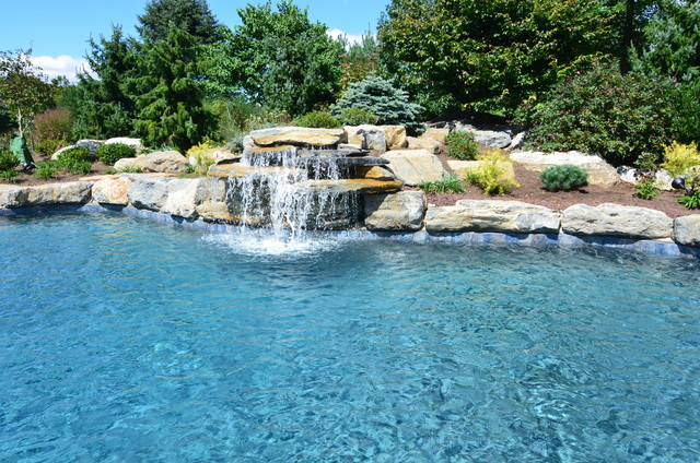 In ground pool with boulder waterfall and large spa contemporary pool