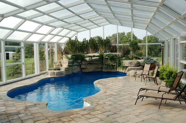 Indoor pool setting with our retractable pool enclosures for Plexiglass pool enclosure