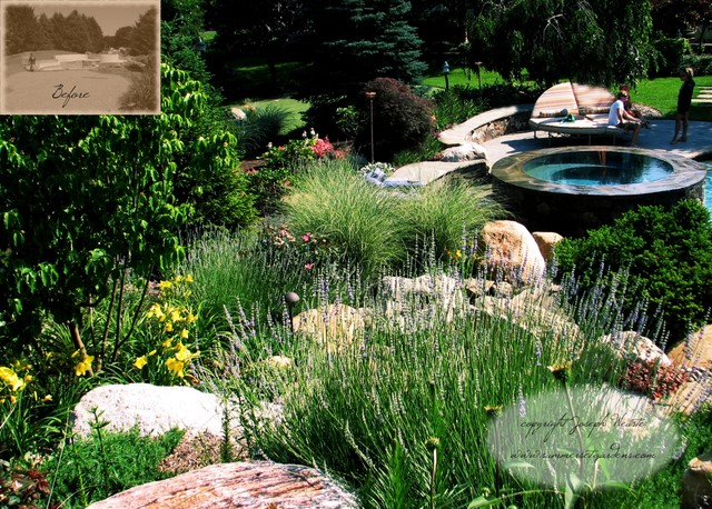Infinity edge spa lush landscaping traditional pool for Pool garden edging
