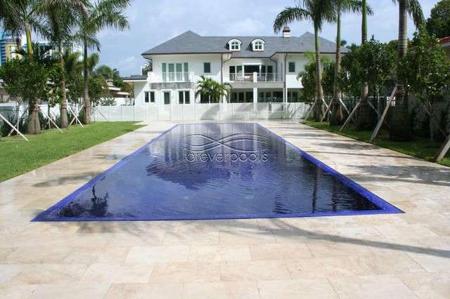 Infinity pool with solid dark blue glass tile contemporary pool miami by foreverpools for Swimming pool construction miami