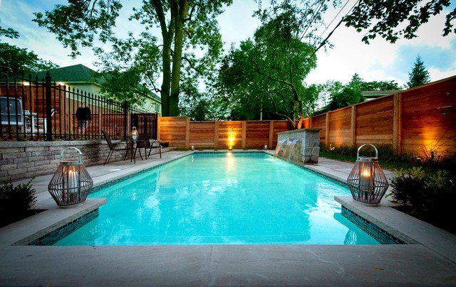 Intimate Backyard Pool Oasis on modern houses with pools, modern rectangle pools, modern water features with pools, modern pools with pools, modern small backyards with grass, modern backyard ideas, modern bedrooms with pools,