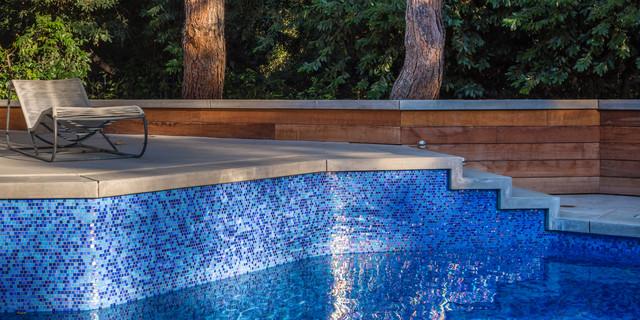 Iridescent glass tile pool seating area modern pool for Pool area tiles