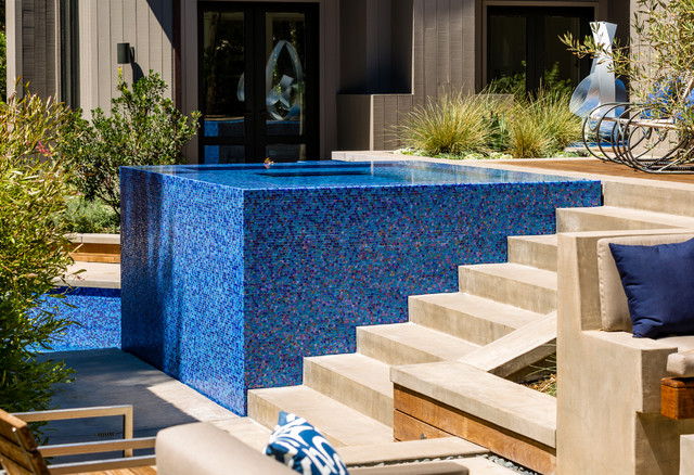 Iridescent glass tile spa stair detail modern pool for Terry pool design jewelry