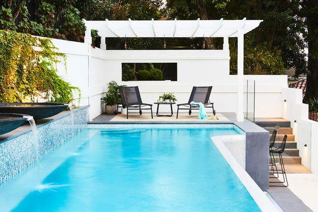Contemporary Custom Shaped Pool In Melbourne With A Water Feature And  Concrete Pavers.