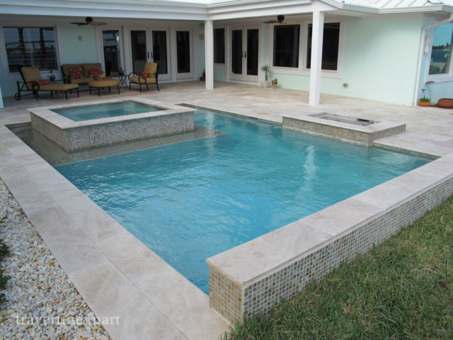 ivory tumbled travertine pool deck tiles, pavers, and pool coping