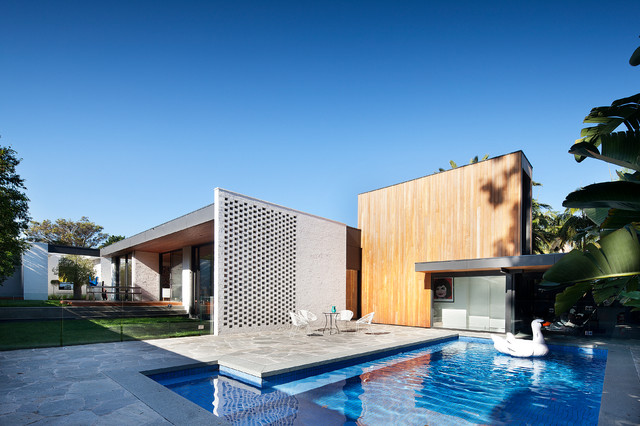 Trendy side yard stone and l-shaped pool photo in Melbourne