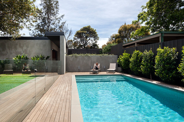 Photo of a medium sized contemporary back rectangular lengths swimming pool in Melbourne with decking.