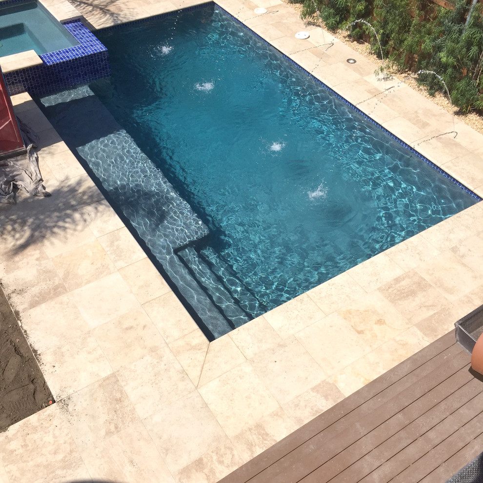 Inspiration for a mid-sized transitional backyard stone and rectangular natural pool fountain remodel in Los Angeles