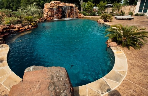 Lagoon style swimming pool with waterfall grotto with spa ...