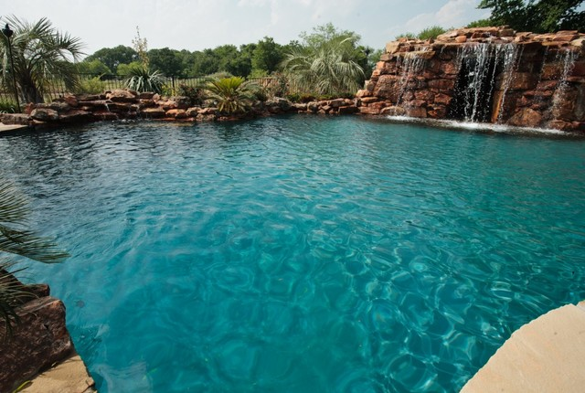 Lagoon Style Swimming Pool With Waterfall Grotto With Spa