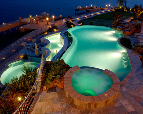 Pool and lakehouse lighting ideas. Photo credit: Traditional Pool by The Woodlands Pools & Spas Texas Pools