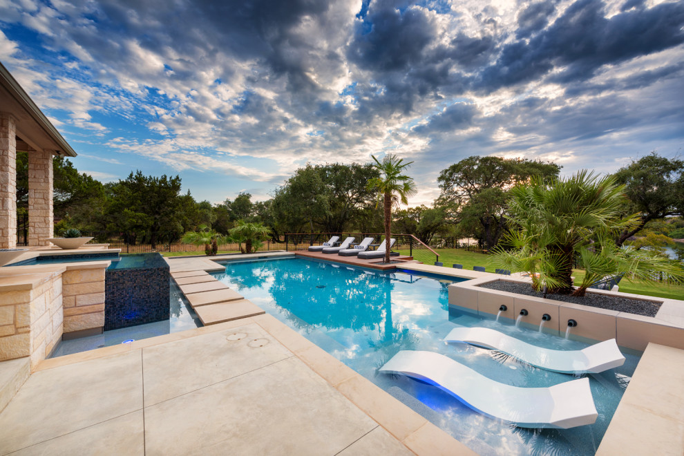 Inspiration for a large contemporary backyard custom-shaped and tile hot tub remodel in Austin