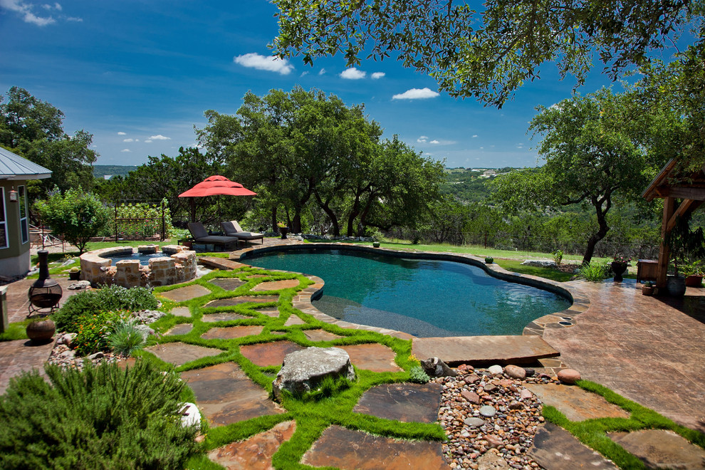 Pool - traditional stone and custom-shaped pool idea in Austin