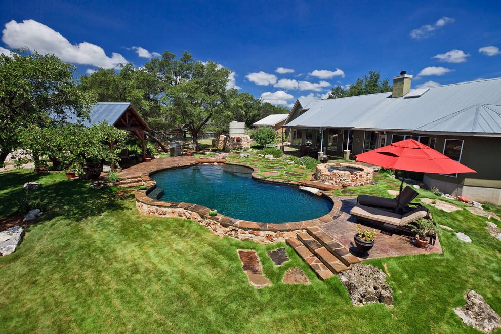 Inspiration for a rustic backyard custom-shaped pool remodel in Austin