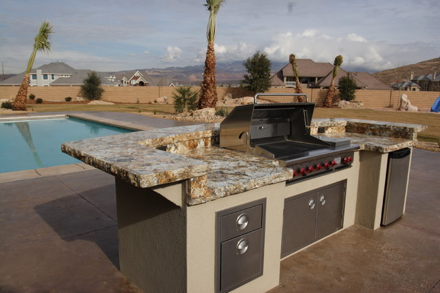 Example of a mid-sized classic backyard concrete and rectangular lap hot tub design in Salt Lake City