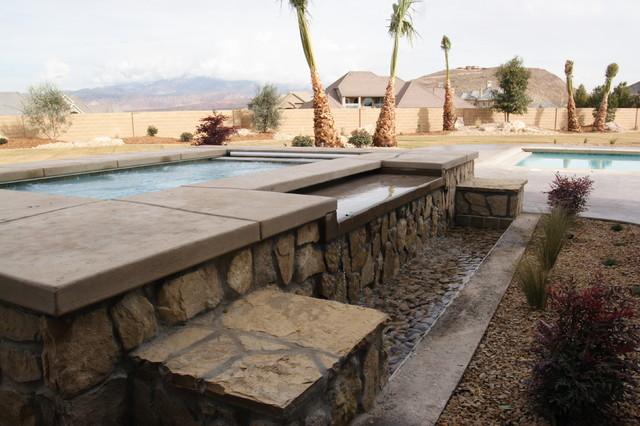 Inspiration for a mid-sized timeless backyard concrete and rectangular lap hot tub remodel in Salt Lake City