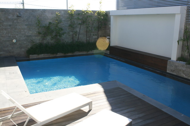Lap pool design with the clever use of glass panel windows for Pool design newcastle