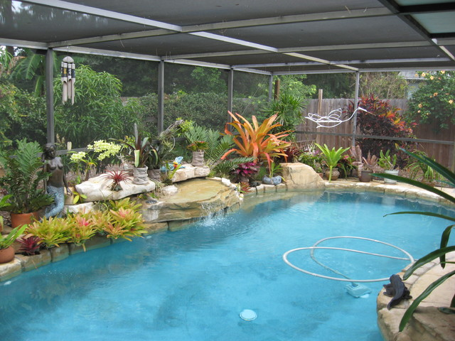 Ledger waterfall tropical pool tampa by rock 39 n for Decor around swimming pool