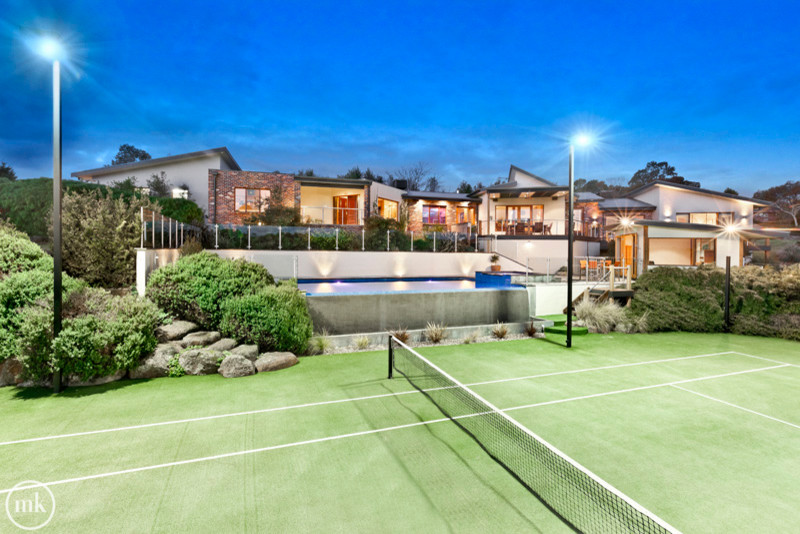 How to Construct a Tennis Court in Your Backyard