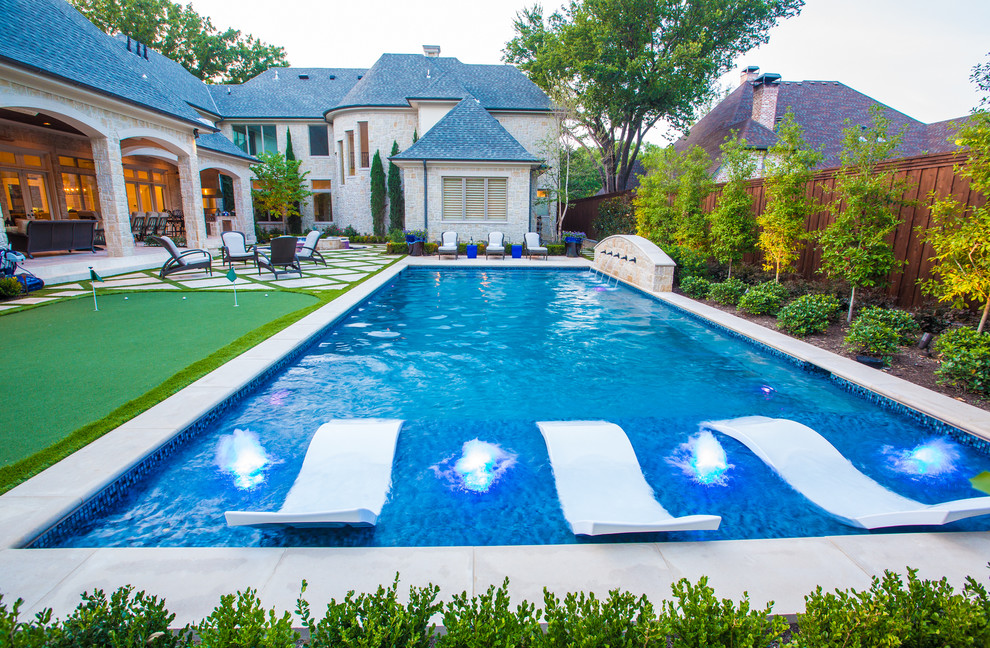 Inspiration for a mid-sized mediterranean backyard rectangular and concrete paver lap pool fountain remodel in Dallas