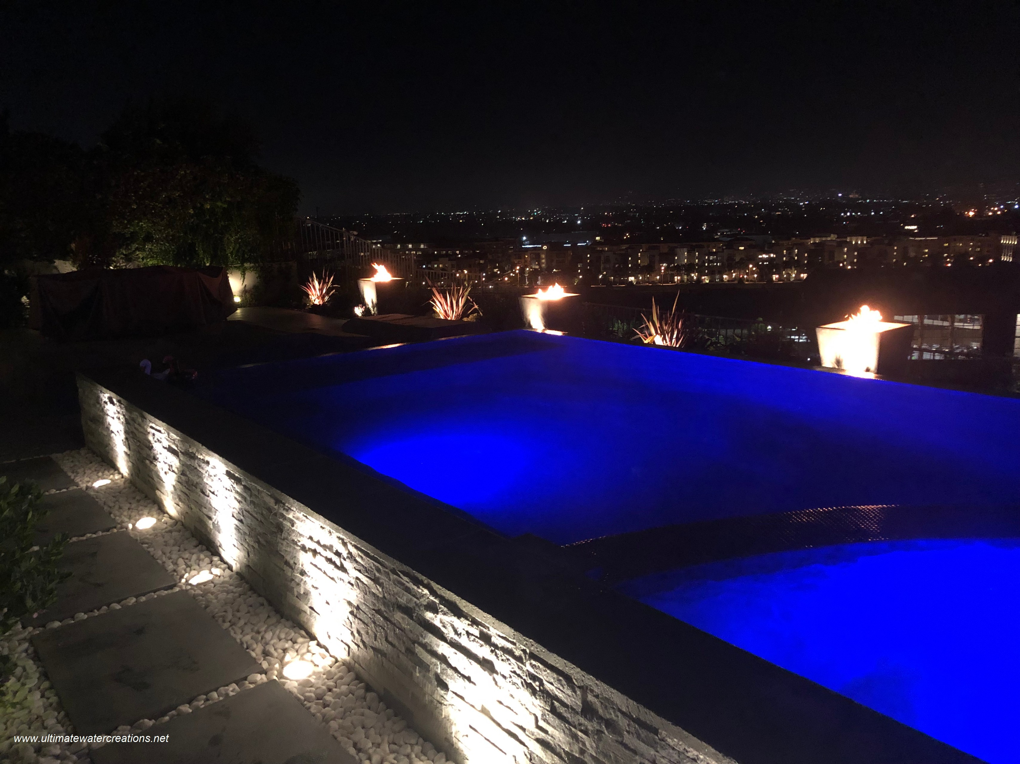 Los Angeles -  Contemporary Hillside Pool & Spa with Colored Water Spillways