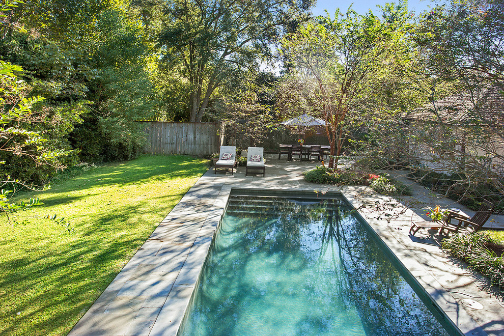 Inspiration for a mid-sized timeless backyard stone and rectangular pool remodel in New Orleans