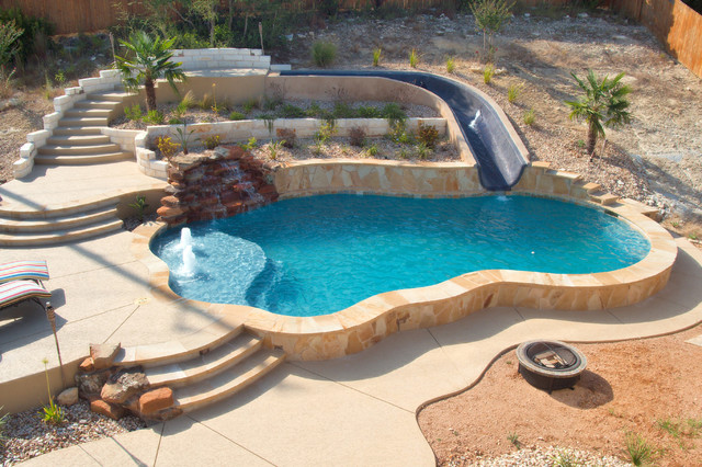 Luxury backyards traditional pool austin by cody for Pool design sloped yard