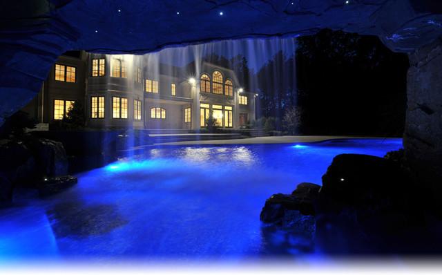 Luxury inground swimming pool grotto design for Swimming pool grotto design