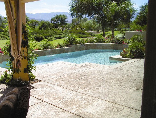 Luxury Swimming Pool With A Stamped Concrete Pool Deck