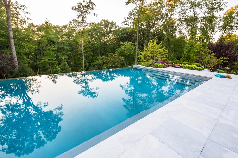 Luxury vanishing edge swimming pool and outdoor living ...