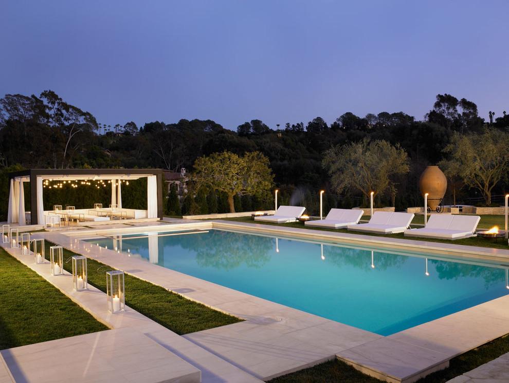 Pool - mediterranean concrete and rectangular pool idea in San Diego